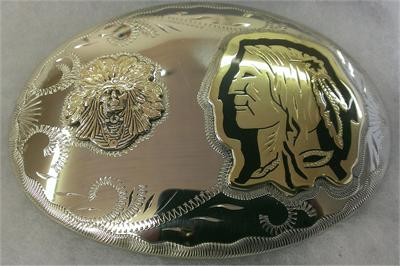 Beautifully crafted belt buckle made of three metals with silhouettes of native american chief and warrior on the buckle.