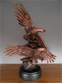 Majestic Eagles with outstretched wings and talons that look like bronze statues.