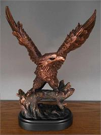 Eagle standing on tree with wings outstretched bronze look figurine