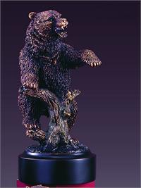Grizzly bear figurine features an angry upright bear.