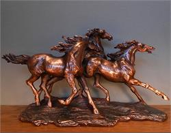 Running horse trio features three horses at full gallop, realistically crafted figurine.