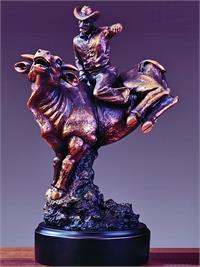 Bull rider figurine features bull and cowboy.