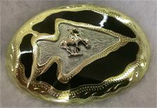 Oval buckle with Arrowhead shape in the center with design enclosed within the arrowhead. Fineky detailed outhwestern belt buckle from Tombstone, AZ