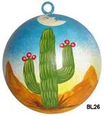 Man in the Moon smiles skyward over the saguaro cactus in full bloom on this delightful ceramic ball ornament that can be used year round