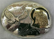 Double eagle belt buckle features a finely detailed eagle head and flying eagle with talons extended on a carved background.