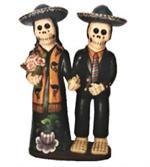 Skeleton couple dressed in their best are holding hands, ready for the Day of the Dead festivities.