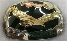 Belt Buckle with soaring eagle, moon and clouds over black, made of nickel silver, brass and copper.