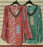 Multi colored print blouse with beaded neckline is available in two colors